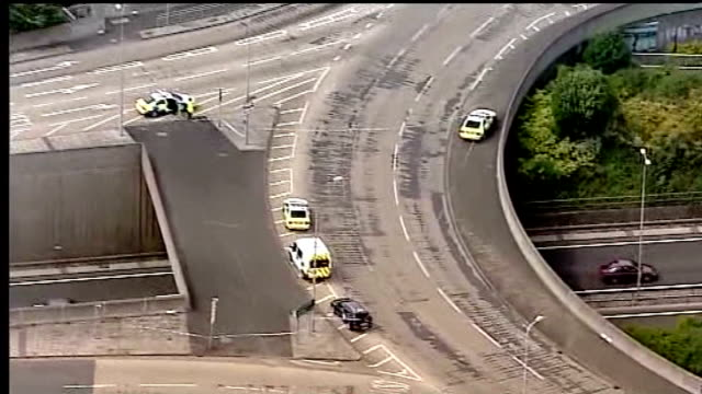 telephone threats by moat played in court r04071003 tyne and wear newcastle east denton of roundabout at junction where moat shot rathband - moat stock videos & royalty-free footage
