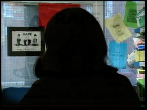 rape within marriage; int 'women against rape' centre, woman at desk answers phone; intvw unidentified woman who went through 19 years of being raped... - married stock videos & royalty-free footage