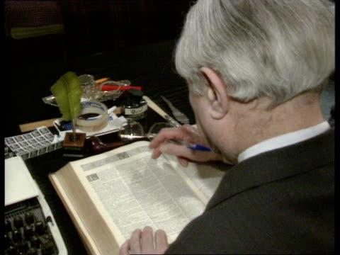 rape within marriage; lionel daiches qc sitting at desk reading legal case book; intvw daiches ; ruseler i/c; - 性的暴行点の映像素材/bロール