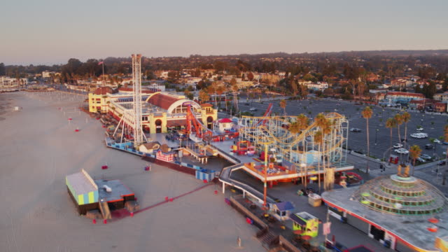 rapid drone flight over santa cruz beach and boardwalk at sunrise - santa cruz california stock videos and b-roll footage