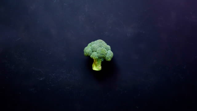 rapid of vegetables on black color background - vegetable stock videos & royalty-free footage