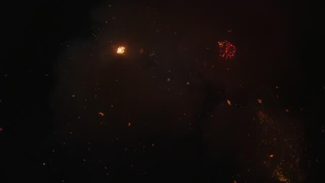 vídeos y material grabado en eventos de stock de rapidly discharging ground mortars shoot sparks and smoke from below frame - sparks