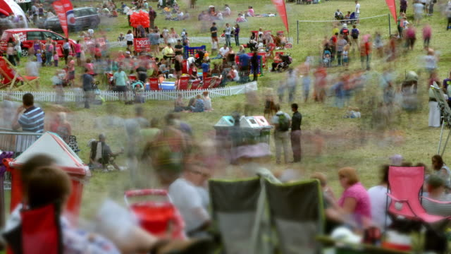 Rapidly moving blurred crowds of people at the Bristol International Balloon Fiesta