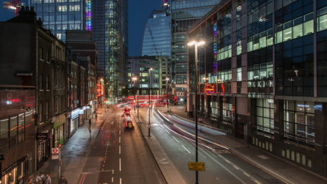 rapidly moving city traffic flows through bishopsgate in the city of london during a day to night timelapse transition - traffic time lapse stock videos & royalty-free footage