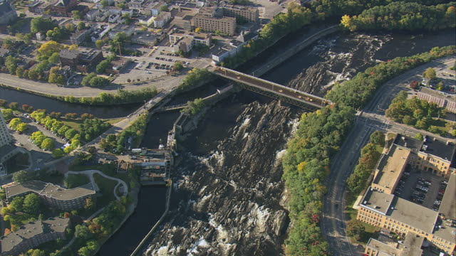 aerial rapids and whitewater below pawtucket falls on the merrimack river, a bridge, and the city along the riverbanks / lowell, massachusetts, united states - lowell stock videos & royalty-free footage