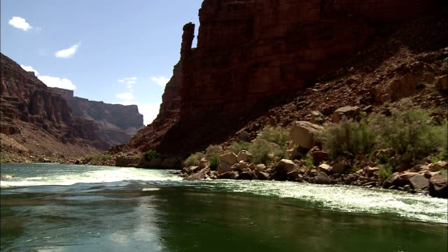 Rapids cause sections of the Colorado River waters to become rough in Arizona's Grand Canyon.
