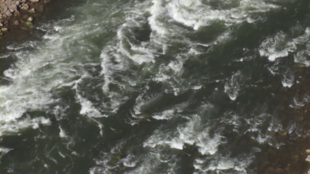 rapids churn in the colorado river. - river colorado stock videos & royalty-free footage