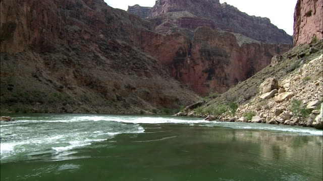 rapids interrupt the smooth flow of the colorado river in arizona's grand canyon. - river colorado stock videos & royalty-free footage