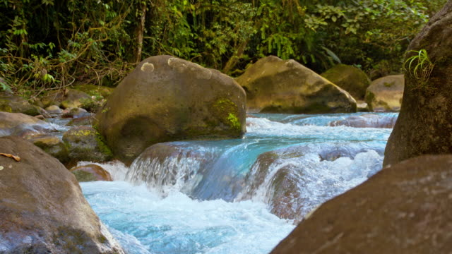 slo mo rapids on the rio celeste - turquoise coloured stock videos & royalty-free footage