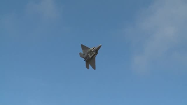 Raptor stealth fighter demonstration team performing at Arctic Thunder 2014