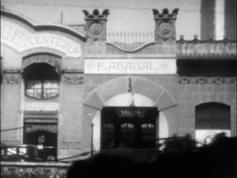 vídeos de stock e filmes b-roll de / rare footage of francisco 'paco' abadal and his hupmobile dealership in barcelona spain / abadal conducted a test of the 1929 hupmobile model a... - 1920
