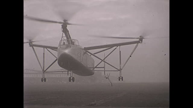 rare footage of the cierva air horse autogiro helicopter test flights - landing, pilots visible - hovering stock videos & royalty-free footage