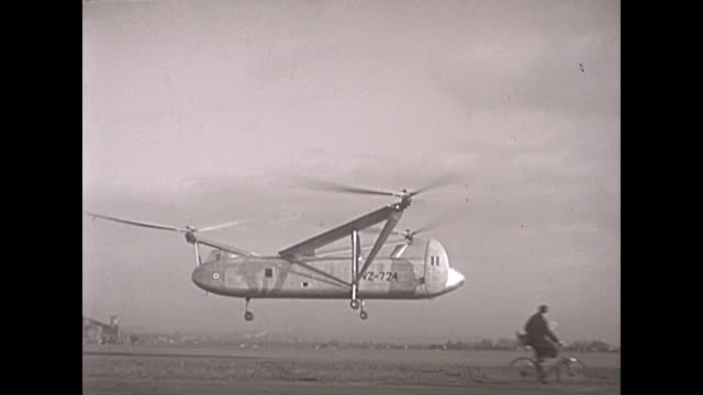 rare footage of the cierva air horse autogiro helicopter test flights - cyclist - hovering stock videos & royalty-free footage