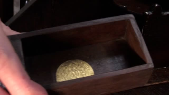 rare gold coin from 1365 worth around £3,000 has been found in a secret drawer of an old bureau worth just £60 by an auction house in derbyshire.... - drawer stock videos & royalty-free footage