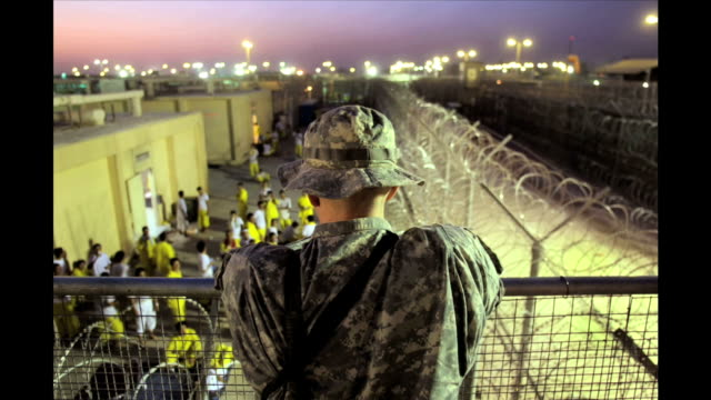 a rare look inside camp cropper a usrun holding facility for various detainees in baghdad - iraq stock videos & royalty-free footage