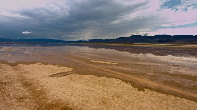 rare rainfall at mojave desert california - mud flat stock videos and b-roll footage