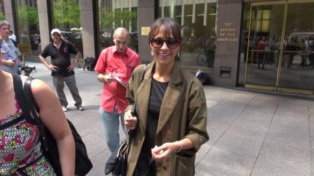 Rashida Jones exits SiriusXM Radio and signs for a fan in New York 08/02/12