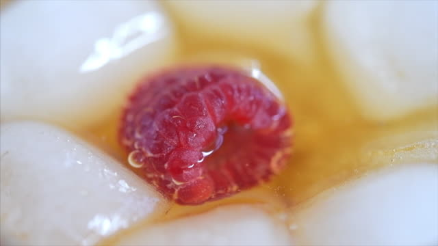 raspberry fruit falling in slow motion to garnish a cocktail - garnish stock videos & royalty-free footage
