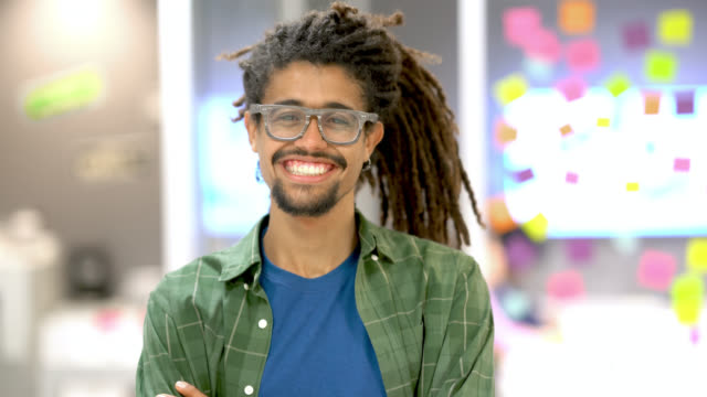 rasta young man walking from the boardroom to the camera with arms crossed smiling at the office - alternative lifestyle stock videos & royalty-free footage