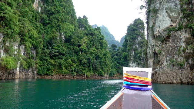 ratchaprapha dam at khao sok national park, suratthani province, thailand. - longtail boat stock videos & royalty-free footage