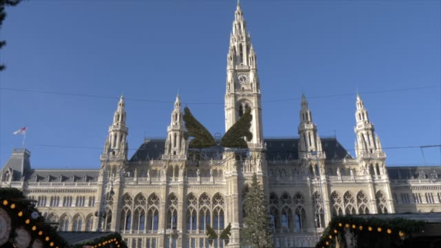 rathaus and christmas market in rathausplatz at christmas, vienna, austria, europe - vienna austria stock videos & royalty-free footage