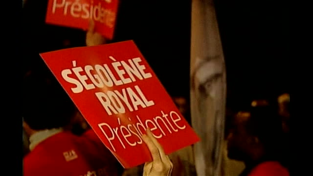 ratings boost for presidential candidate segolene royal rennes int young man wearing 'les jeune pour segolene' tshirt waving flag and shouting... - rennes frankreich stock-videos und b-roll-filmmaterial