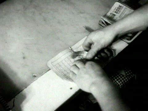 ration book points are torn out of ration book and placed in boxes in a shop 1954 - food stamps stock videos & royalty-free footage