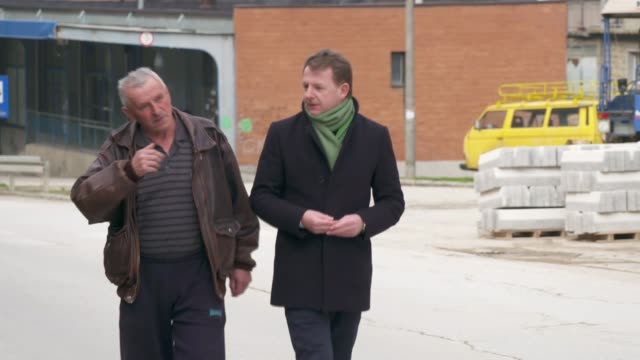 ratko mladic appears before icc on charges of genocide; bosnia and herzegovina: republika srpsk: srebrenica: ext close shot grave at srebrenica... - ratko mladic stock videos & royalty-free footage