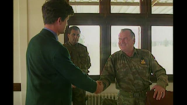 ratko mladic sentenced to life imprisonment for srebrenica genocide; bsp050995023 / 5.9.1995 location unknown: reporter shaking hands with mladic... - ratko mladic stock videos & royalty-free footage