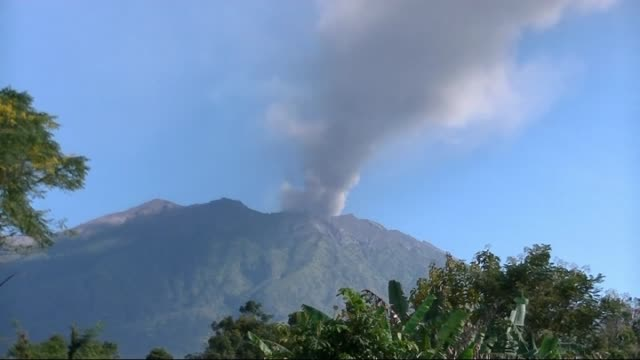 raung volcano spews ash clouds to the air in east jawa region of jakarta and 800 people were evacuated on 6 july 2015 - vulkanausbruch stock-videos und b-roll-filmmaterial