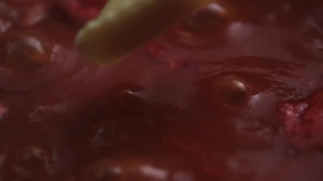 ravioli falling into tomato sauce - sauce stock videos and b-roll footage