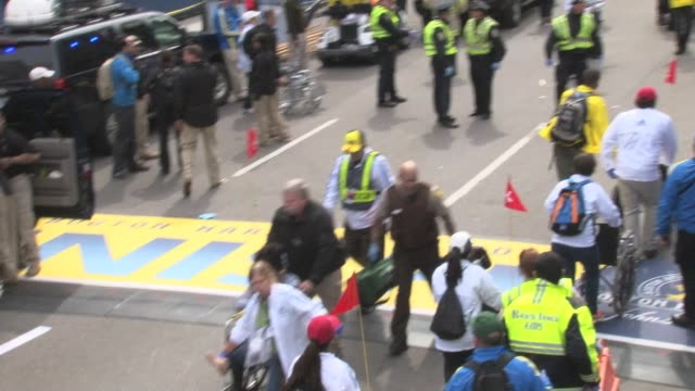 / raw footage of the chaos and confusion following the boston marathon bombing - bombing stock videos & royalty-free footage