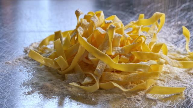 raw homemade pasta tagliatelle - tagliatelle stock videos and b-roll footage