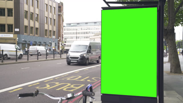 raw look green screen billboard on the street in the daytime - advertisement stock videos & royalty-free footage