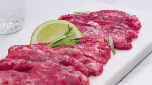 raw meat cut 'anchangsal' (beef thin skirt) / south korea - kotelett stock-videos und b-roll-filmmaterial