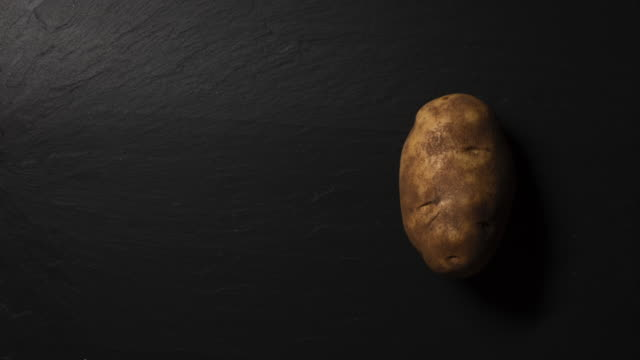 raw potatoes - five objects stock videos & royalty-free footage