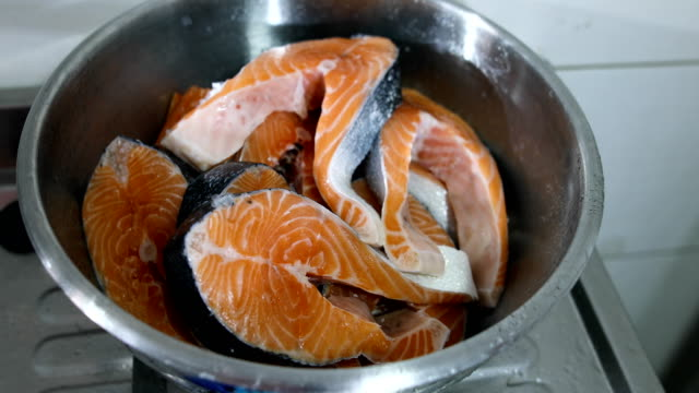 raw salmon cut into pieces in metal bowl - animal body part stock videos & royalty-free footage