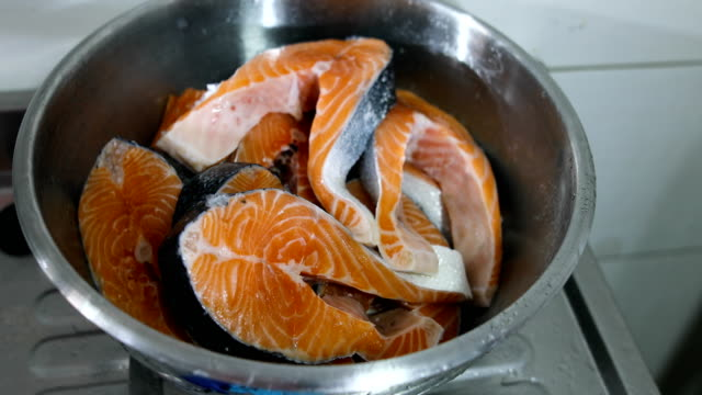raw salmon cut into pieces in metal bowl - omega 3 stock videos & royalty-free footage