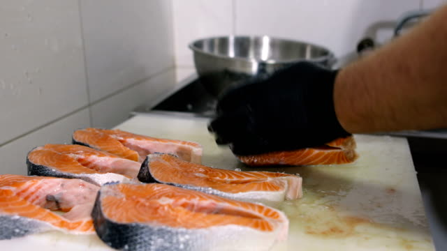 raw salmon cut into pieces - animal body part stock videos & royalty-free footage