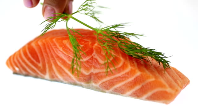 raw salmon filet garnished with dill - toro fish stock videos and b-roll footage