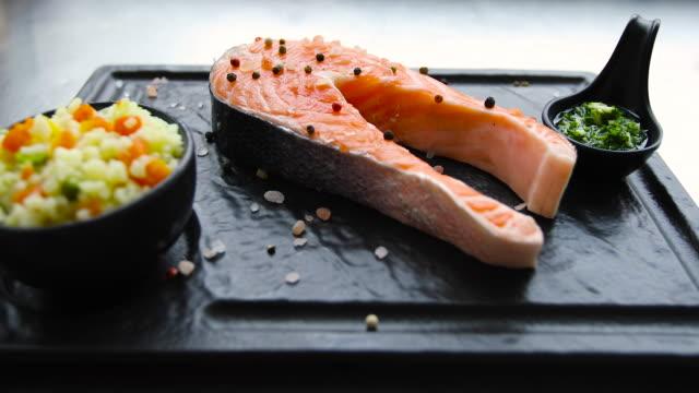 raw salmon steak isolated on white background - salmon salad stock videos & royalty-free footage