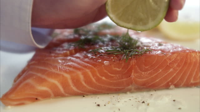 Raw spiced salmon being prepared Sweden.
