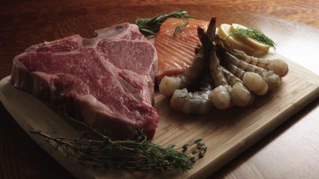 raw t-bone beef steak, shrimp, and salmon gourmet food - ketogenic diet stock videos & royalty-free footage
