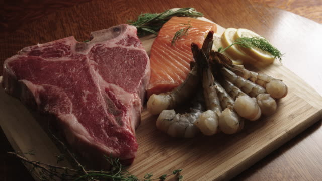 raw t-bone beef steak, shrimp, and salmon gourmet food - prawn seafood stock videos & royalty-free footage