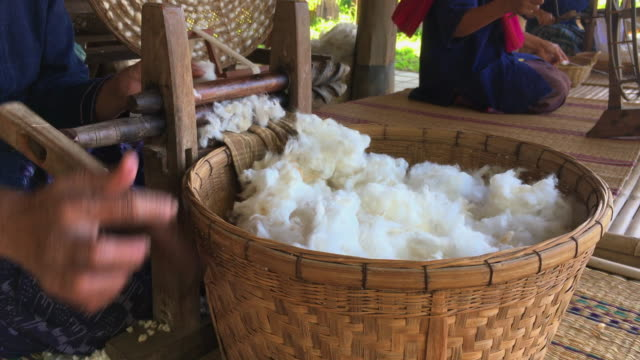 raw yarn production of  folk crafts in thailand. - thread stock videos & royalty-free footage