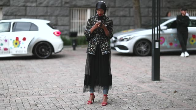 Rawdah wearing a midi skirt denim jeans and a blazer with print is seen during during Oslo Runway SS19 on August 15 2018 in Oslo Norway
