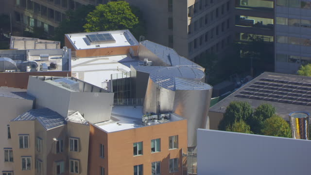 MS AERIAL POV Ray and Maria Stata Center in MIT Campus with city / Cambridge, Massachusetts, United States