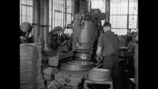 raybestos brake lining factory int factory w/ male worker checking machine employees checking bulletin board w/ employee postings for softball game... - bulletin board stock videos and b-roll footage