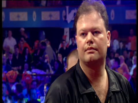 Raymond van Barneveld's last two darts of 11 dart checkout track forwards over supporters celebrating 2003 Embassy World Darts Championships Lakeside...