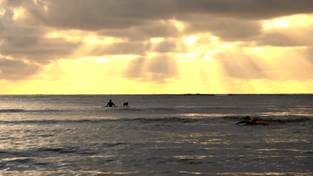 rays of light piercing the clouds off kauai island - butte rocky outcrop stock videos & royalty-free footage